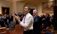 President Barack Obama, Vice President Joe Biden, and senior staff applaud in the Roosevelt Room of the White House, as the House passes the health care reform bill, March 21, 2010. (Official White House Photo by Pete Souza)  This official White House photograph is being made available only for publication by news organizations and/or for personal use printing by the subject(s) of the photograph. The photograph may not be manipulated in any way and may not be used in commercial or political materials, advertisements, emails, products, promotions that in any way suggests approval or endorsement of the President, the First Family, or the White House.