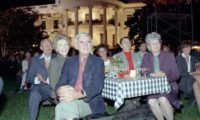 10/6/1983 President Reagan Nancy Reagan Paul Laxalt Bob Michel Corrine Michel and Carol Laxalt watch the Performance by Oak Ridge Boys during the Barbecue for Members of Congress on the South Lawn