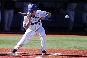 Tyler Zabojnik attempts to bunt during a game March 10, 2015, against Adams State University at Falcon Field, Colo. Zabojnik is an infielder for the U.S. Air Force Academy Falcons baseball team. Air Force baseball had a season-high 17 hits, 13 for extra bases, in a 13-5 win over Adams State. (U.S. Air Force photo/Bill Evans)