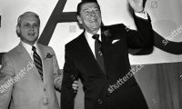 Mandatory Credit: Photo by Anonymous/AP/Shutterstock (6609279a) Ronald Reagan, Dave Treen Republican Ronald Reagan waves as Louisiana Gov. Dave Treen holds on to his arm during a breakfast in Baton Rouge, Louisiana, where he is campaigning for the state's first ever primary on Saturday Ronald Reagan and Gov. Dave Treen, Baton Rouge, USA