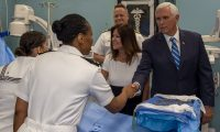 190618-N-FO574-1067  MIAMI (June 18, 2019) Vice President Mike Pence greets Lt. Gwendolyn Mann, from Hampton, Va., and second lady Karen Pence greets Hospital Corpsman 1st Class Edna Wallace, from El Paso, Texas, during a tour aboard the hospital ship USNS Comfort (T-AH 20). Comfort is working with health and government partners in Central America, South America, and the Caribbean to provide care on the ship and at land-based medical sites, helping to relieve pressure on national medical systems strained by an increase in Venezuelan migrants. (U.S. Navy photo by Mass Communication Specialist Seaman Jordan R. Bair/Released)