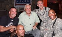 Former Miami Dolphins head coach Don Shula (center) poses for a photo with a group of service members at the Pat Tillman United Service Organizations, a building on Bagram Air Field, July 15, during a celebrity visit to Afghanistan. (Photo by U.S. Army Capt. Michael Greenberger, 5th Mobile Public Affairs Detachment)